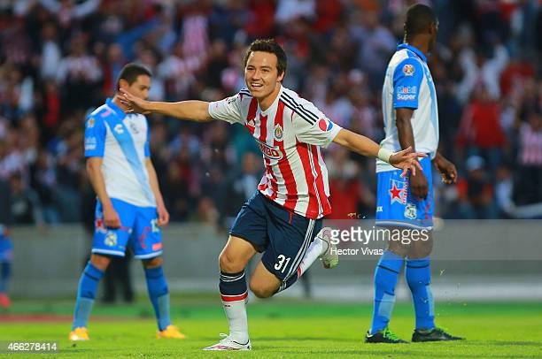Erick Torres of Chivas celebrates after scoring the first goal of his team during a match between Puebla and Chivas as part of 10th round Clausura...