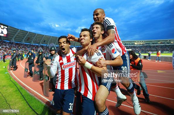 Erick Torres of Chivas celebrates with teammates after scoring the second goal of his team during a match between Puebla and Chivas as part of 10th...