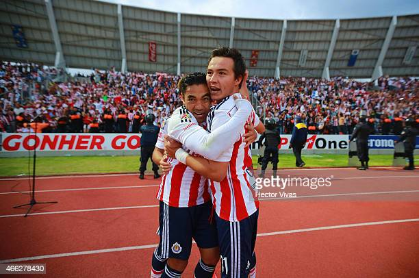 Erick Torres of Chivas celebrates with teammates after scoring the first goal of his team during a match between Puebla and Chivas as part of 10th...