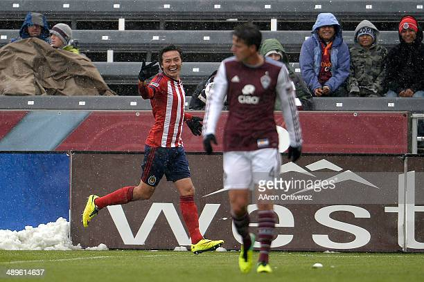 Erick Torres of Chivas USA celebrates his 10 goal as Marc Burch of Colorado Rapids walks up field during the second half Chivas USA defeated the...