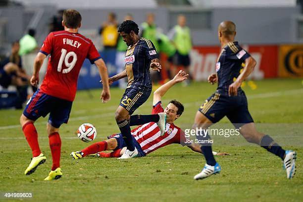 Erick Torres of Chivas USA slides in for the ball past Donny Toia of Chivas USA in the second half at StubHub Center on May 31 2014 in Los Angeles...