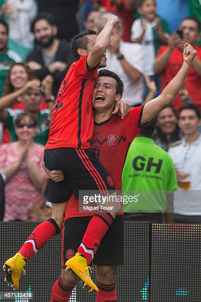 Erick Torres of Mexico celebrates after scoring with Paul Aguilar during a friendly match between Mexico and Panama at Corregidora Stadium on October...