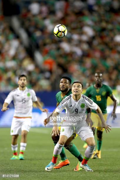 Erick Torres of Mexico fights for control of the ball against Jermaine Taylor of Jamaica in the first half during the 2017 CONCACAF Gold Cup at...