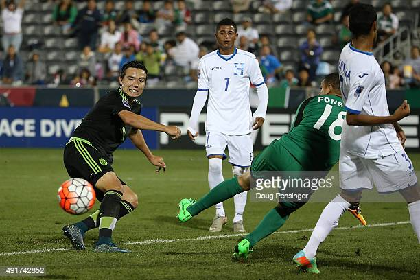 Erick Torres of Mexico has his shot stopped by goalkeeper Harold Fonseca of Honduras during 2015 CONCACAF Olympic Qualifying at Dick's Sporting Goods...