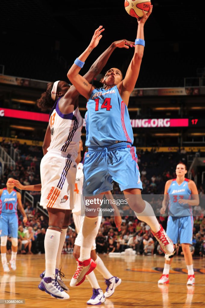 Ericka de Souza of the Atlanta Dream shoots against Nakia Sanford of the Phoenix Mercury on August 11 2011 at US Airways Center in Phoenix Arizona...