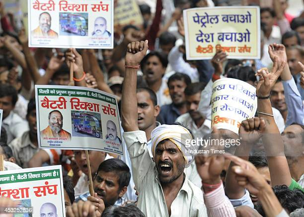 Erickshaw drivers protest at Jantar Mantar demanding the restoration of the erickshaws on Delhi streets on August 6 2014 in New Delhi India The Delhi...