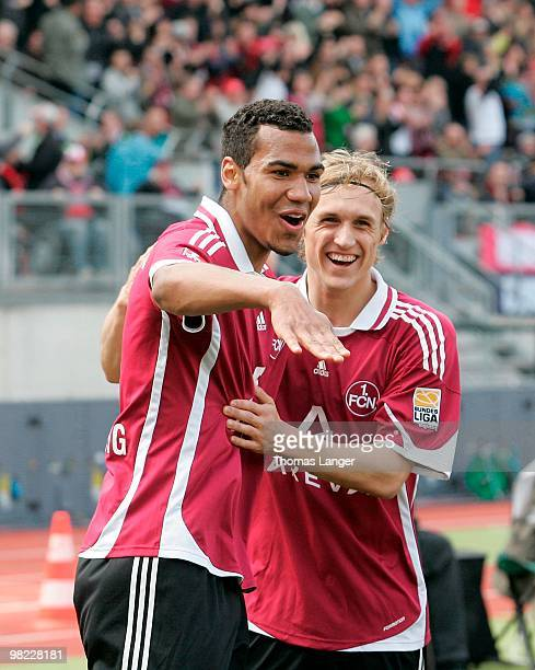 EricMaxim ChoupoMoting and Marcel Risse of Nuernberg celebrate ChoupoMotings 20 goal during the Bundesliga match between 1 FC Nuernberg and FSV Mainz...