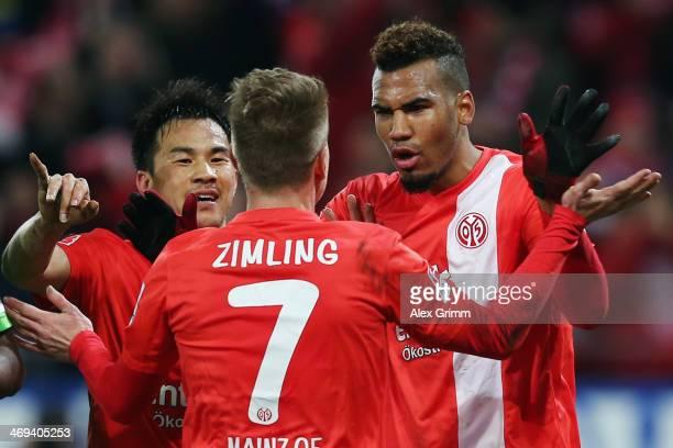 EricMaxim ChoupoMoting of Mainz celebrates his team's second goal with team mates Niki Zimling and Shinji Okazaki during the Bundesliga match between...