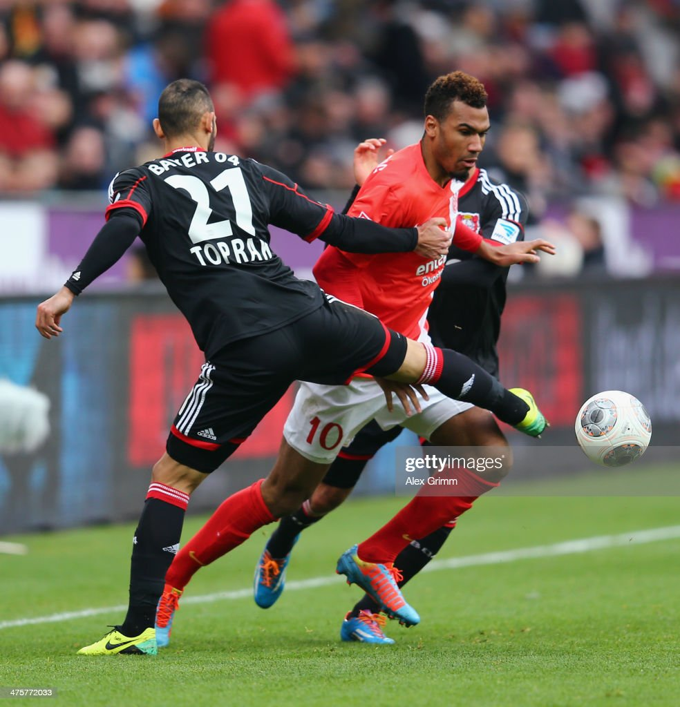Eric-Maxim Choupo-Moting (C) of Mainz is challenged by <a gi-track='captionPersonalityLinkClicked' href=/galleries/search?phrase=Emre+Can&family=editorial&specificpeople=5909273 ng-click='$event.stopPropagation()'>Emre Can</a> (back) and <a gi-track='captionPersonalityLinkClicked' href=/galleries/search?phrase=Oemer+Toprak&family=editorial&specificpeople=5395932 ng-click='$event.stopPropagation()'>Oemer Toprak</a> of Leverkusen during the Bundesliga match between Bayer 04 Leverkusen and 1. FSV Mainz 05 at BayArena on March 1, 2014 in Leverkusen, Germany.