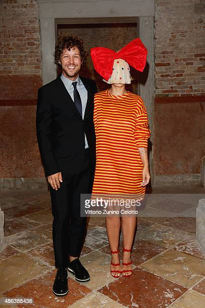 Erik Anders Lang and Sia attend the Miu Miu Women's Tales Dinner during the 72nd Venice Film Festival at Ca' Corner della Regina on September 3 2015...