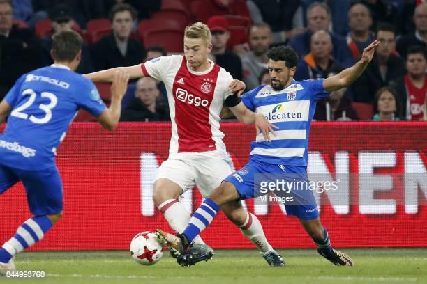 Erik Bakker of PEC Zwolle Matthijs de Ligt of Ajax Youness Mokhtar of PEC Zwolle during the Dutch Eredivisie match between Ajax Amsterdam and PEC...