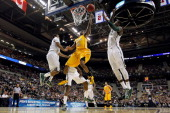 Erik Buggs of the Valparaiso Crusaders drives for a shot attempt in the first half against Branden Dawson of the Michigan State Spartans during the...