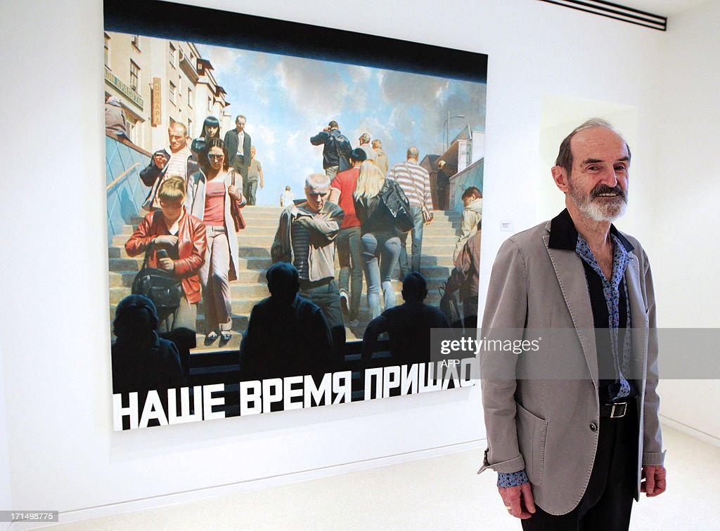 Erik Bulatov poses in front of his art work 'Notre Temps est Venu' exposed at the Villa Paloma, the new museum of Monaco, on June 25, in Monaco. AFP PHOTO / JEAN CHRISTOPHE MAGNENET