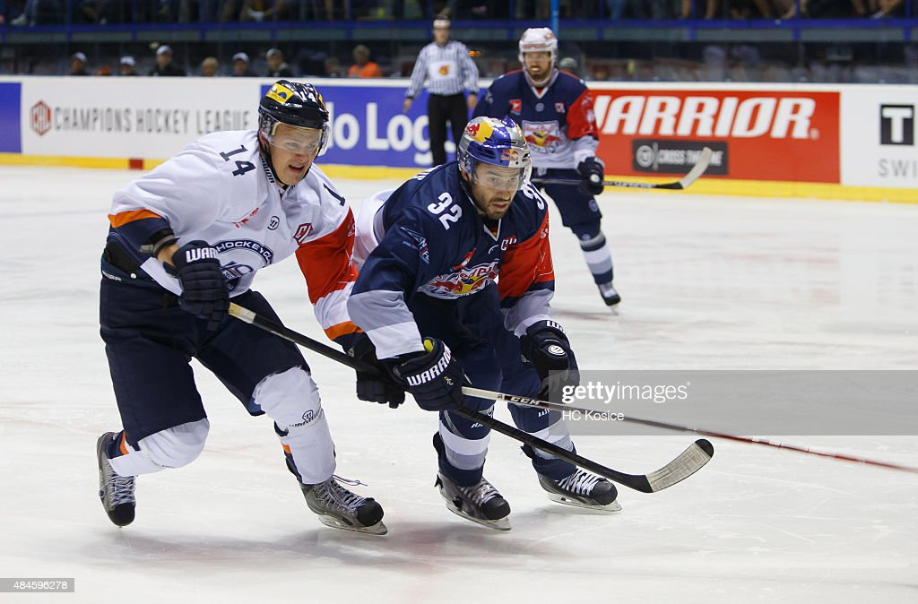 Erik Cernak of Kosice and Frederic St Denis of Munich in action during the Champions Hockey League group stage game between HC Kosice and Red Bull...