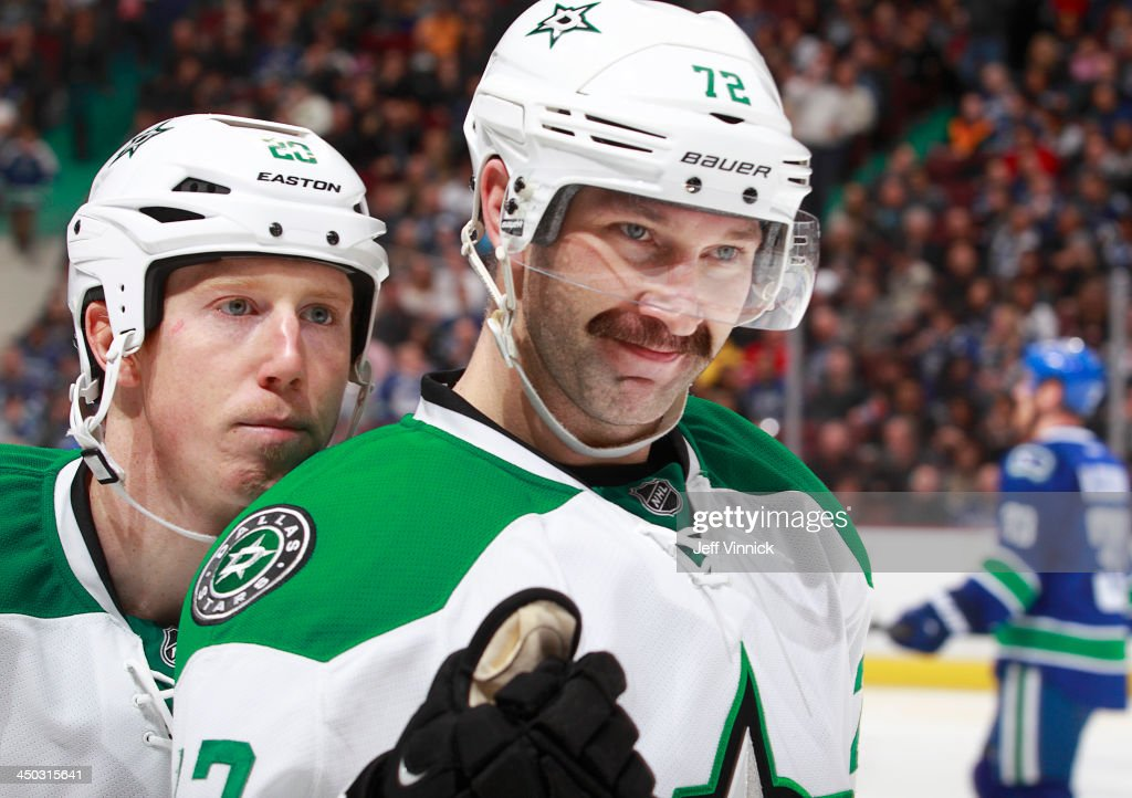 Erik Cole #72 and Cody Eakin #20 of the Dallas Stars celebrate a goal against the Vancouver Canucks during their NHL game at Rogers Arena on November 17, 2013 in Vancouver, British Columbia, Canada. Dallas won 2-1.