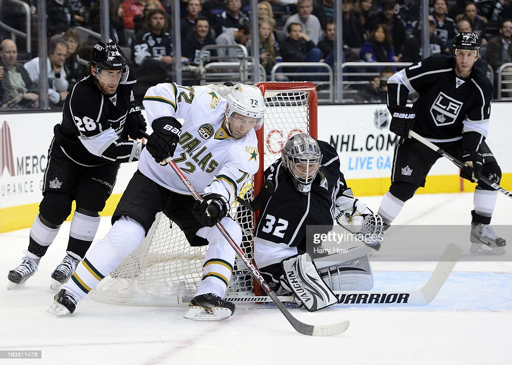 Erik Cole #72 of the Dallas Stars attempts a shot on Jonathan Quick #32 of the Los Angeles Kings as Jarret Stoll #28 and Rob Scuderi #7 look for a rebound during the first period at Staples Center on March 7, 2013 in Los Angeles, California.