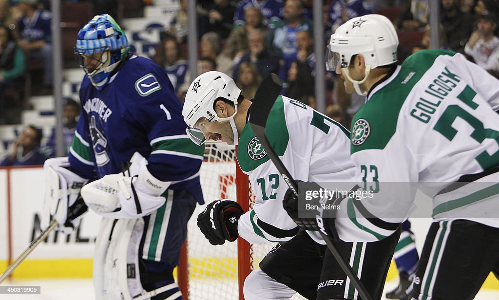Erik Cole #72 of the Dallas Stars celebrates his goal against goaltender Roberto Luongo #1 of the Vancouver Canucks with teammate Alex Goligoski #33 of the Dallas Stars during the third period of their NHL game at Rogers Arena on November 17, 2013 in Vancouver, British Columbia, Canada.
