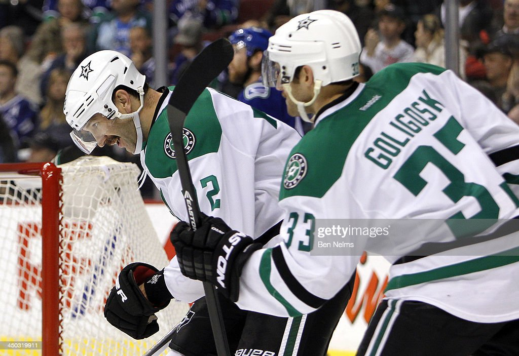 <a gi-track='captionPersonalityLinkClicked' href=/galleries/search?phrase=Erik+Cole&family=editorial&specificpeople=204754 ng-click='$event.stopPropagation()'>Erik Cole</a> #72 of the Dallas Stars celebrates his goal against the Vancouver Canucks with teammate <a gi-track='captionPersonalityLinkClicked' href=/galleries/search?phrase=Alex+Goligoski&family=editorial&specificpeople=791866 ng-click='$event.stopPropagation()'>Alex Goligoski</a> #33 of the Dallas Stars during the third period of their NHL game at Rogers Arena on November 17, 2013 in Vancouver, British Columbia, Canada.