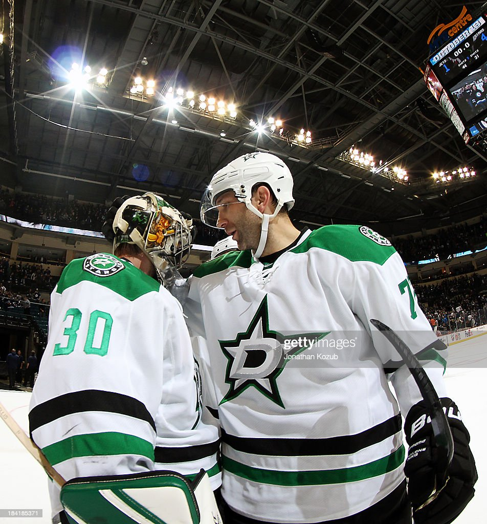 <a gi-track='captionPersonalityLinkClicked' href=/galleries/search?phrase=Erik+Cole&family=editorial&specificpeople=204754 ng-click='$event.stopPropagation()'>Erik Cole</a> #72 of the Dallas Stars congratulates goaltender <a gi-track='captionPersonalityLinkClicked' href=/galleries/search?phrase=Dan+Ellis&family=editorial&specificpeople=2235265 ng-click='$event.stopPropagation()'>Dan Ellis</a> #30 following a 4-1 victory over the Winnipeg Jets at the MTS Centre on October 11, 2013 in Winnipeg, Manitoba, Canada.