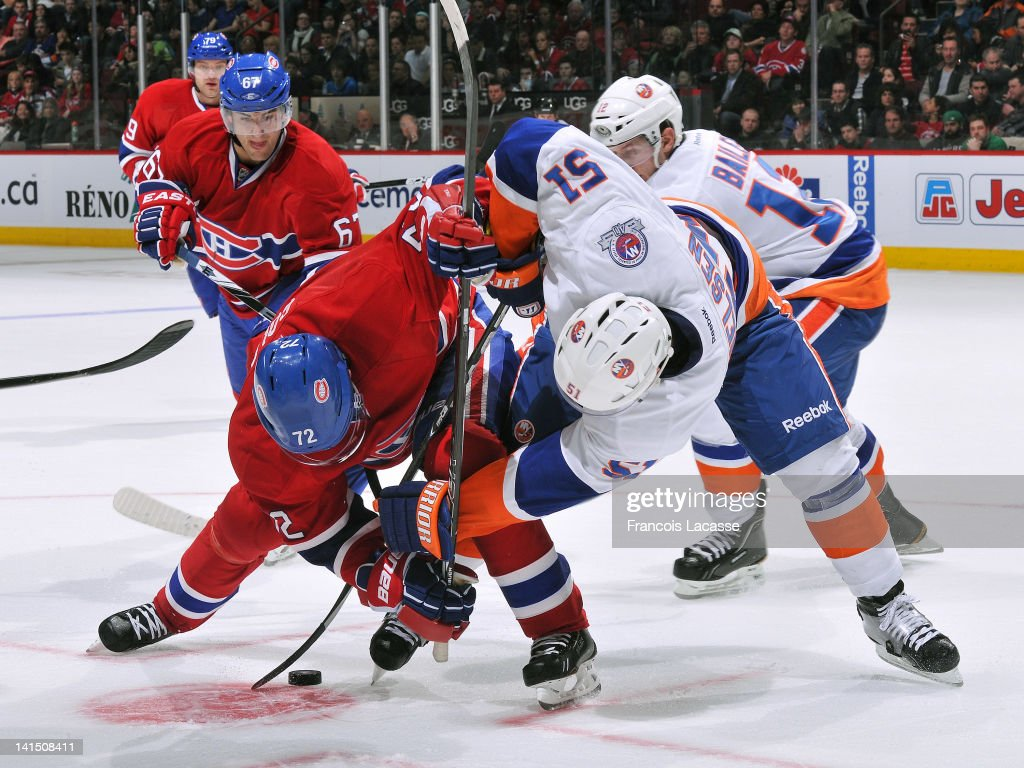 <a gi-track='captionPersonalityLinkClicked' href=/galleries/search?phrase=Erik+Cole&family=editorial&specificpeople=204754 ng-click='$event.stopPropagation()'>Erik Cole</a> #72 of the Montreal Canadiens faces off with <a gi-track='captionPersonalityLinkClicked' href=/galleries/search?phrase=Frans+Nielsen&family=editorial&specificpeople=634894 ng-click='$event.stopPropagation()'>Frans Nielsen</a> #51 of the New York Islanders during the NHL game on March 17, 2012 at the Bell Centre in Montreal, Quebec, Canada.