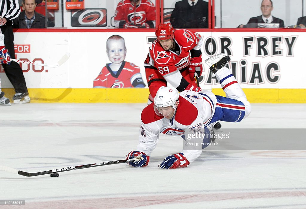 <a gi-track='captionPersonalityLinkClicked' href=/galleries/search?phrase=Erik+Cole&family=editorial&specificpeople=204754 ng-click='$event.stopPropagation()'>Erik Cole</a> #72 of the Montreal Canadiens falls to ice after getting tangled with <a gi-track='captionPersonalityLinkClicked' href=/galleries/search?phrase=Chad+LaRose&family=editorial&specificpeople=546026 ng-click='$event.stopPropagation()'>Chad LaRose</a> #59 of the Carolina Hurricanes during an NHL game on Apri 5, 2012 at PNC Arena in Raleigh, North Carolina.