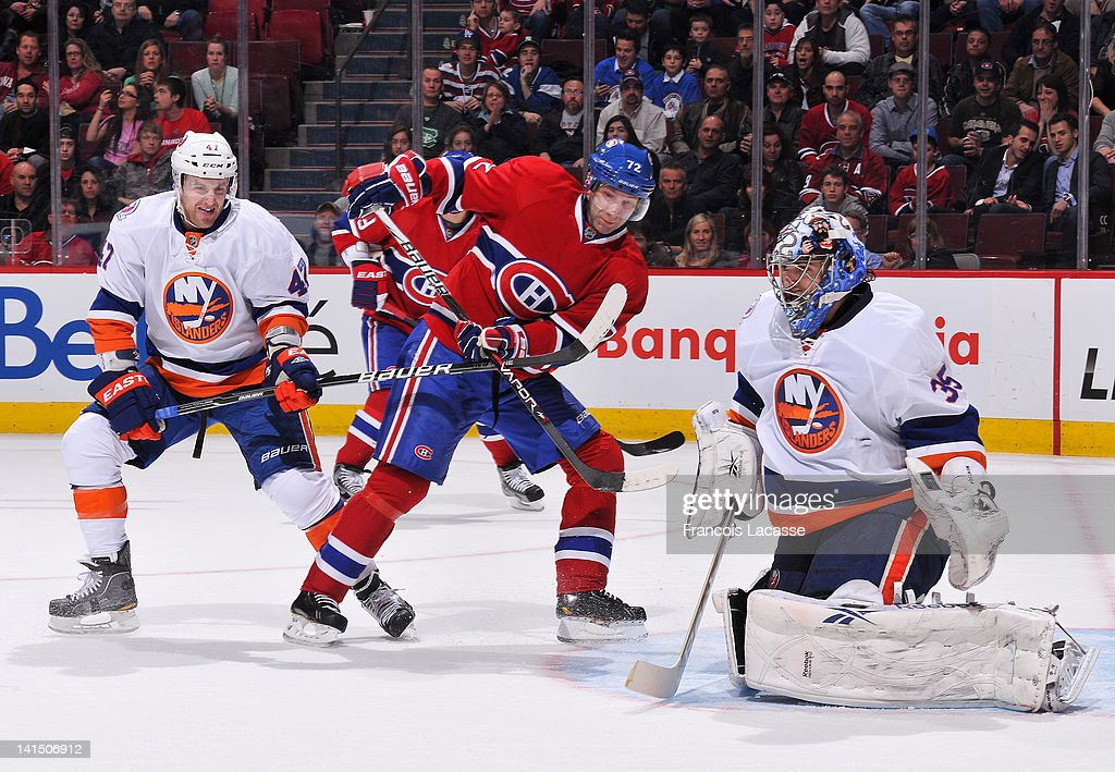 <a gi-track='captionPersonalityLinkClicked' href=/galleries/search?phrase=Erik+Cole&family=editorial&specificpeople=204754 ng-click='$event.stopPropagation()'>Erik Cole</a> #72 of the Montreal Canadiens looks for a rebound in front of goalie <a gi-track='captionPersonalityLinkClicked' href=/galleries/search?phrase=Al+Montoya&family=editorial&specificpeople=213916 ng-click='$event.stopPropagation()'>Al Montoya</a> #35 of the New York Islanders as Dylan Reese #42 follows the play during the NHL game on March 17, 2012 at the Bell Centre in Montreal, Quebec, Canada.
