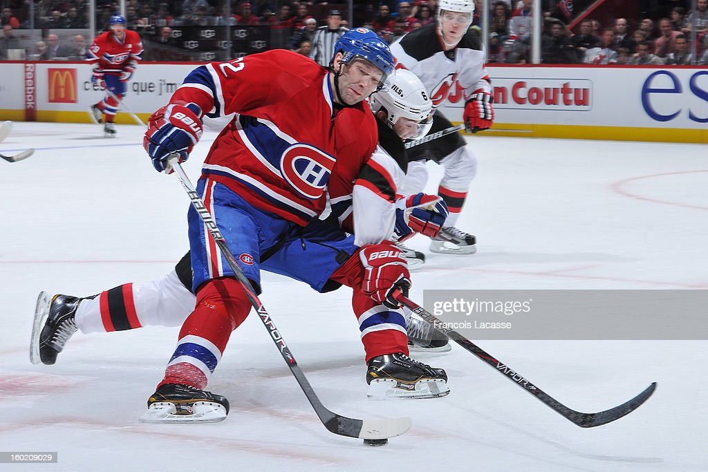 <a gi-track='captionPersonalityLinkClicked' href=/galleries/search?phrase=Erik+Cole&family=editorial&specificpeople=204754 ng-click='$event.stopPropagation()'>Erik Cole</a> #72 of the Montreal Canadiens tries to skate the puck around defenceman <a gi-track='captionPersonalityLinkClicked' href=/galleries/search?phrase=Andy+Greene&family=editorial&specificpeople=3568726 ng-click='$event.stopPropagation()'>Andy Greene</a> #6 of the New Jersey Devils during the NHL game on January 27, 2013 at the Bell Centre in Montreal, Quebec, Canada.