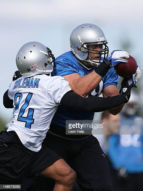 Erik Coleman and Will Heller of the Detroit Lions battle for the ball during the morning practice session on July 28 2012 in Allen Park Michigan