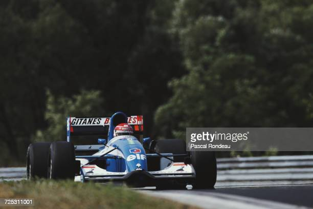 Erik Comas of France drivesf the Ligier Gitanes Blondes Ligier JS37 Renault V10 during practice for the Hungarian Grand Prix on 11 August 1992 at the...