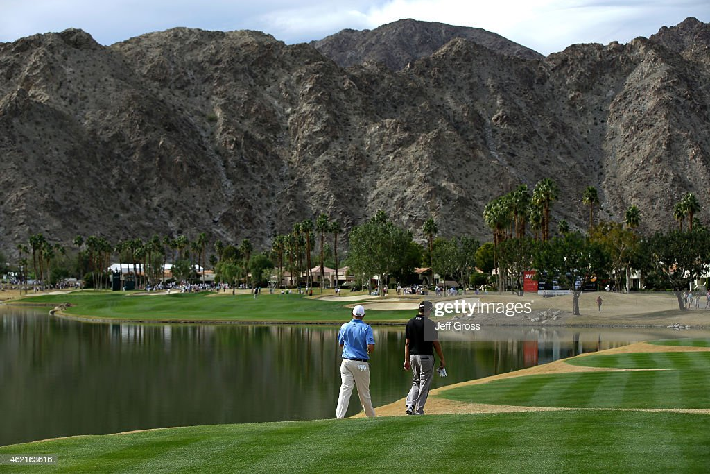Erik Compton and Bill Haas of the United States walk down the 10th hole during the final round of the Humana Challenge in partnership with The...