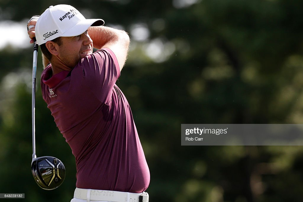 <a gi-track='captionPersonalityLinkClicked' href=/galleries/search?phrase=Erik+Compton&family=editorial&specificpeople=3450396 ng-click='$event.stopPropagation()'>Erik Compton</a> plays a shot from the 15th tee during the final round of the Quicken Loans National at Congressional Country Club on June 26, 2016 in Bethesda, Maryland.