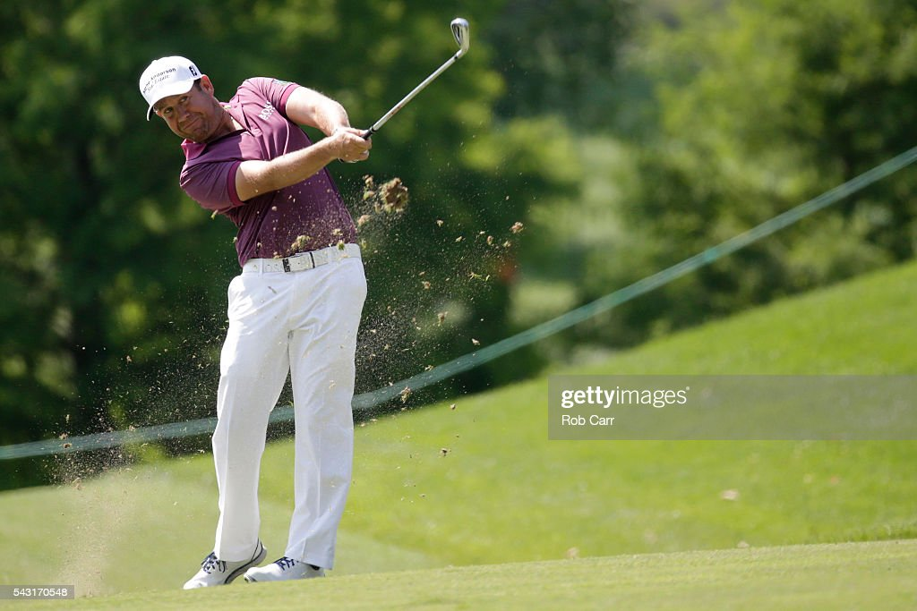 <a gi-track='captionPersonalityLinkClicked' href=/galleries/search?phrase=Erik+Compton&family=editorial&specificpeople=3450396 ng-click='$event.stopPropagation()'>Erik Compton</a> plays a shot on the ninth hole during the final round of the Quicken Loans National at Congressional Country Club on June 26, 2016 in Bethesda, Maryland.