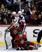 Erik Condra and Matt Kassian of the Ottawa Senators celebrate a goal by Condra as Darcy Kuemper and Marco Scandella of the Minnesota Wild looks on...