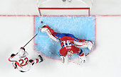 Erik Condra of Ottawa Senators scores a goal against Carey Price of the Montreal Canadiens in Game Five of the Eastern Conference Quarterfinals...