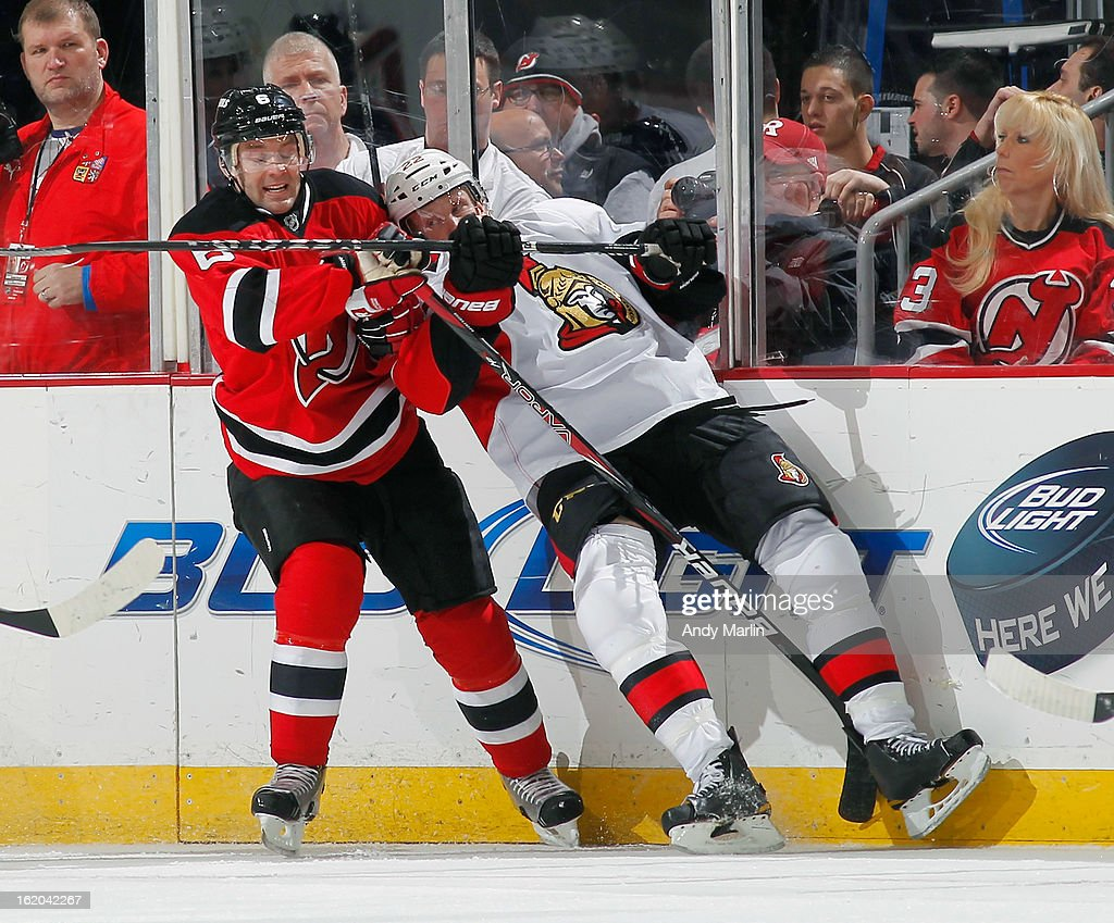 Erik Condra #22 of the Ottawa Senators and Andy Greene #6 of the New Jersey Devils battle for position during the game at the Prudential Center on February 18, 2013 in Newark, New Jersey.