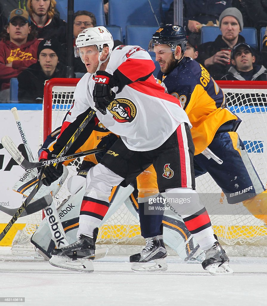 Erik Condra of the Ottawa Senators and Zemgus Girgensons of the Buffalo Sabres battle for position in front of the net on February 10 2015 at the...