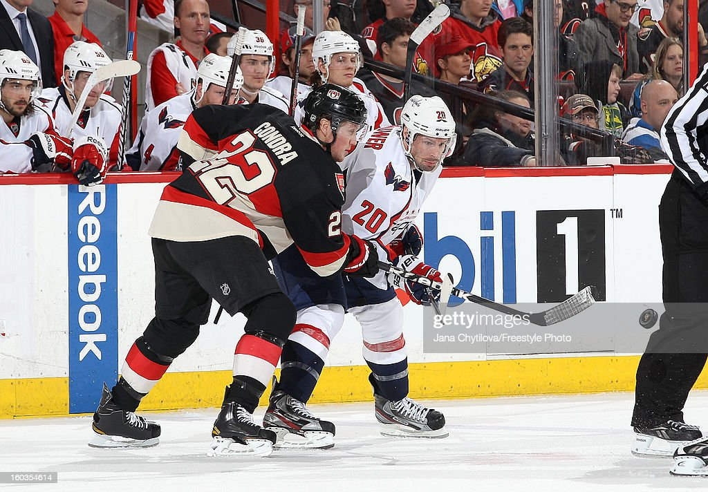 <a gi-track='captionPersonalityLinkClicked' href=/galleries/search?phrase=Erik+Condra&family=editorial&specificpeople=6254234 ng-click='$event.stopPropagation()'>Erik Condra</a> #22 of the Ottawa Senators battles for faceoff position against <a gi-track='captionPersonalityLinkClicked' href=/galleries/search?phrase=Troy+Brouwer&family=editorial&specificpeople=4155305 ng-click='$event.stopPropagation()'>Troy Brouwer</a> #20 of the Washington Capitals during an NHL game at Scotiabank Place on January 29, 2013 in Ottawa, Ontario, Canada.