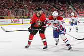 Erik Condra of the Ottawa Senators battles for position against Andrei Markov of the Montreal Canadiens in Game Six of the Eastern Conference...