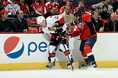 Erik Condra of the Ottawa Senators battles for the puck against Jay Beagle of the Washington Capitals in the first period during an NHL game at...