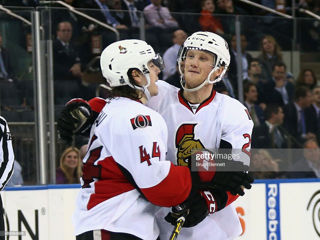 Erik Condra of the Ottawa Senators celebrates an empty net goal by JeanGabriel Pageau against the New York Rangers at Madison Square Garden on April...