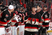 Erik Condra of the Ottawa Senators celebrates his firstperiod goal at the bench with teammate Robin Lehner during a game against the Chicago...