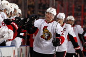 Erik Condra of the Ottawa Senators celebrates his goal with teammates against the Florida Panthers at the BBT Center on December 3 2013 in Sunrise...