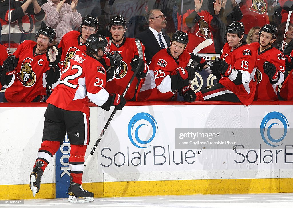 Erik Condra #22 of the Ottawa Senators celebrates his second period goal with teammates on the bench, during an NHL game against the Buffalo Sabres at Scotiabank Place on February 12, 2013 in Ottawa, Ontario, Canada.