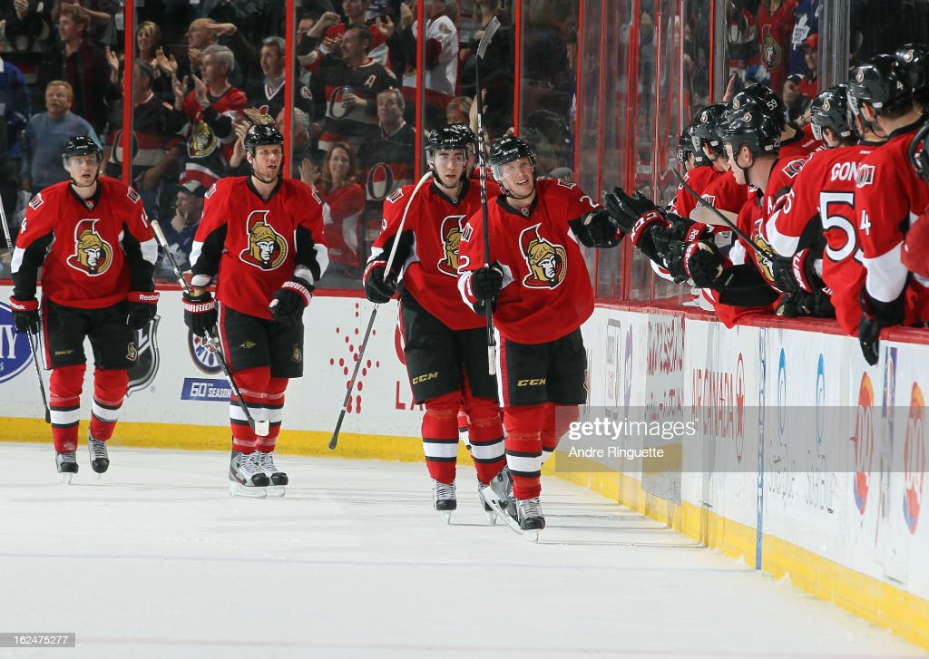 Erik Condra #22 of the Ottawa Senators celebrates his second period goal against the Toronto Maple Leafs with teammates Marc Methot #3, Mika Zibanejad #93 and Colin Greening #14 on February 23, 2013 at Scotiabank Place in Ottawa, Ontario, Canada.