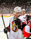 Erik Condra of the Ottawa Senators celebrates his second period goal against the Winnipeg Jets with teammates at the bench on March 4 2015 at the MTS...