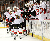Erik Condra of the Ottawa Senators celebrates with teammates as he skates by the bench after scoring a goal in the first period against the Anaheim...