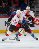 Erik Condra of the Ottawa Senators controls the puck against the Colorado Avalanche at Pepsi Center on January 8 2014 in Denver Colorado The...