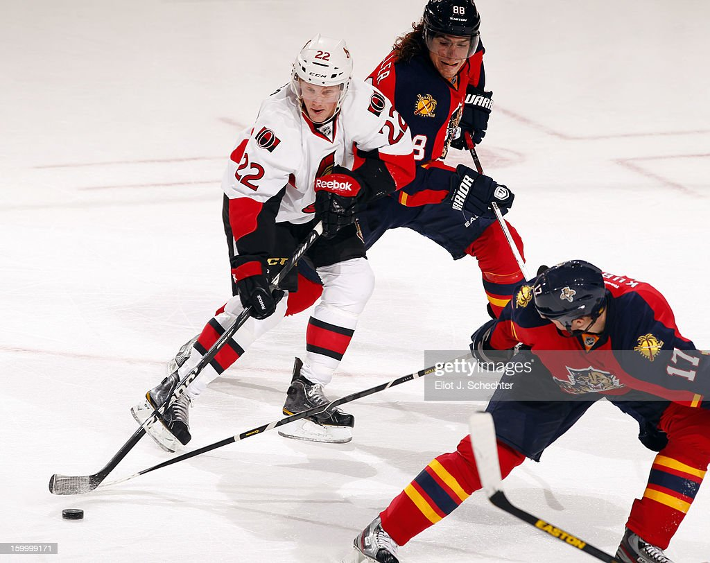 Erik Condra #22 of the Ottawa Senators crosses sticks with Peter Mueller #88 of the Florida Panthers and teammate Filip Kuba #17 at the BB&T Center on January 24, 2013 in Sunrise, Florida.