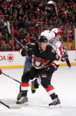 Erik Condra of the Ottawa Senators hip checks Alex Ovechkin of the Washington Capitals during an NHL game at Canadian Tire Centre on December 30 2013...