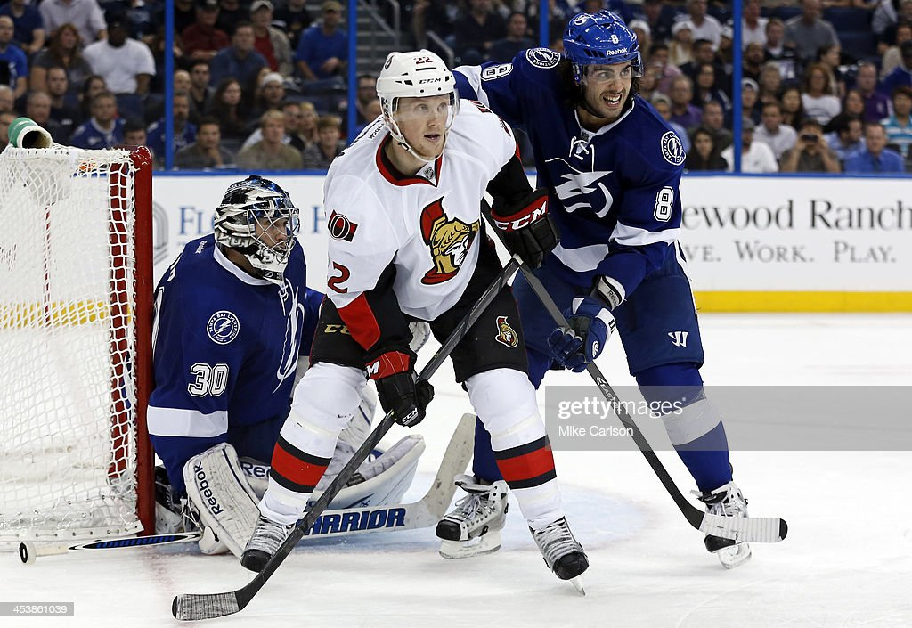 <a gi-track='captionPersonalityLinkClicked' href=/galleries/search?phrase=Erik+Condra&family=editorial&specificpeople=6254234 ng-click='$event.stopPropagation()'>Erik Condra</a> #22 of the Ottawa Senators is defended by <a gi-track='captionPersonalityLinkClicked' href=/galleries/search?phrase=Mark+Barberio&family=editorial&specificpeople=4819242 ng-click='$event.stopPropagation()'>Mark Barberio</a> #8 of the Tampa Bay Lightning in front of <a gi-track='captionPersonalityLinkClicked' href=/galleries/search?phrase=Ben+Bishop&family=editorial&specificpeople=700137 ng-click='$event.stopPropagation()'>Ben Bishop</a> #30 at the Tampa Bay Times Forum on December 5, 2013 in Tampa, Florida.